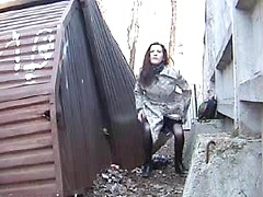 Kinky amateur bitch pissing in public place on spy camera